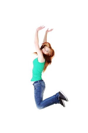 Teen caucasian student jumping and raising hands in the air. Isolated on white background. photo