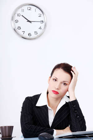 Pretty caucasian tired businesswoman sitting in the office. Stock Photo - 11485851