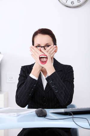 immoral: Businesswoman covering her mouth with hands not to say anything immoral during work.