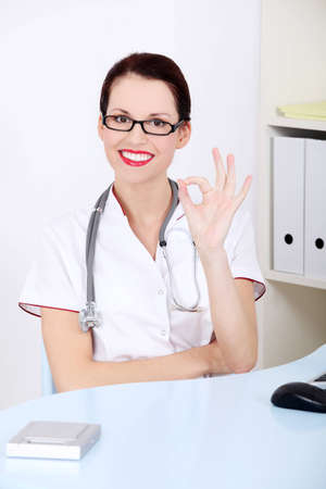 Beautiful caucasian doctor showing perfect gesture. Stock Photo - 11485798