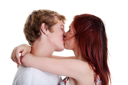 Closeup of young caucasian couple kissing each other against white background. photo