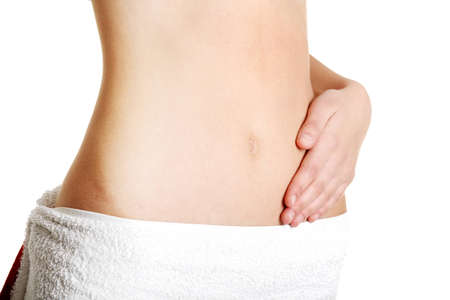 Fit belly closeup with a hand on it, over white. Stock Photo - 11485856