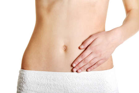 Front view of a fit belly closeup with a hand on it, over white. Stock Photo - 11486745