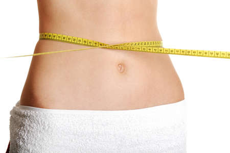 Front view of a fit belly closeup with a measure roung the waist, over white. Stock Photo - 11486472