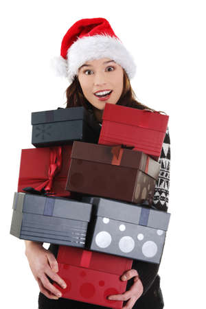 Young woman in santa hat holding christmas boxes, isolated on white background. Stock Photo - 12388277