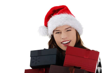 Young woman in santa hat holding christmas boxes, isolated on white background. Stock Photo - 12388272