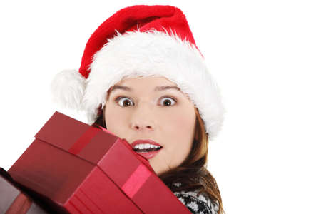 Young woman in santa hat holding christmas boxes, isolated on white background. Stock Photo - 12388305