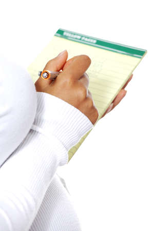 Pregnant woman taking notes in a diary - diary closeup, zoom in on the hand, isolated on a white background. photo