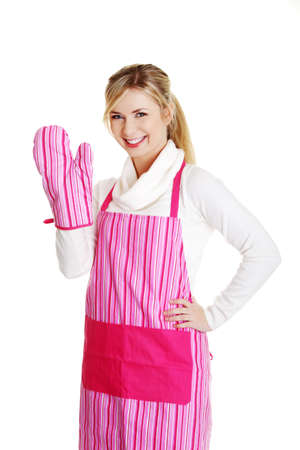 Young housewife in pink apron, isolated on white photo