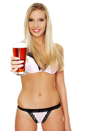 waitresses: Beautiful and sexy young blond woman holding glass of beer, isolated on white