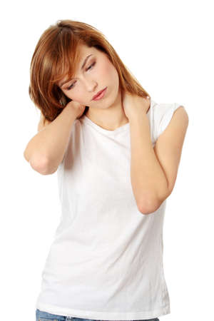 shoulder pain: Teen woman heaving neck pain, isolated on white