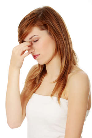 sore eye: Young teen woman with sinus pressure pain