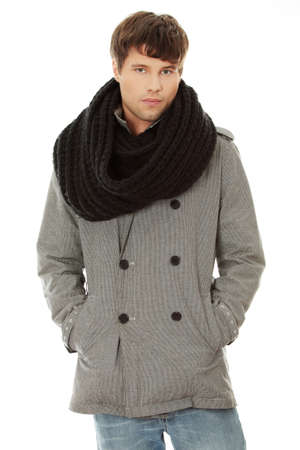 fashion boy: Portrait of handsome man in scarf and coat. Isolated on white background