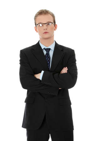Young businessman standing, isoalted on white background photo