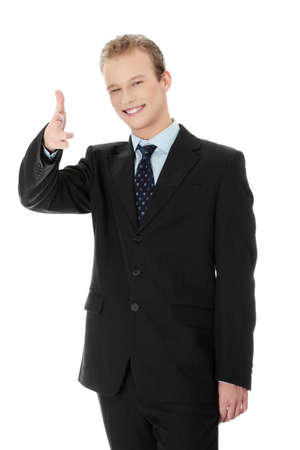 Confident business man gesturing You, isolated on white background photo