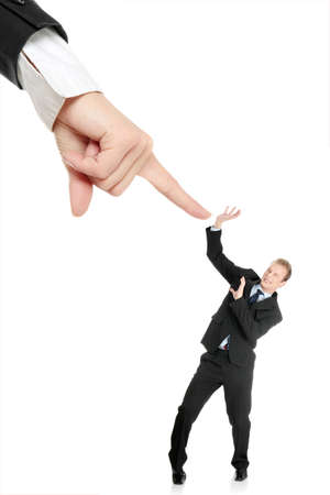 Scared young businessman afraid of big hand pointing on him, isolated on white