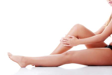 Woman holding on leg. Isolated on white Stock Photo - 12694065