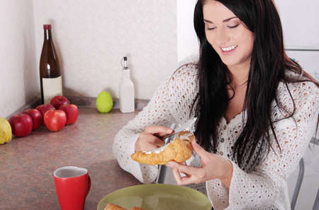 Young Adult Woman Eating Breakfast Stock Photo - 13187750