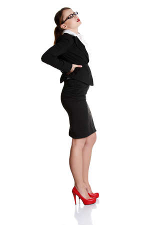 Full length of business woman with backache on white background  photo