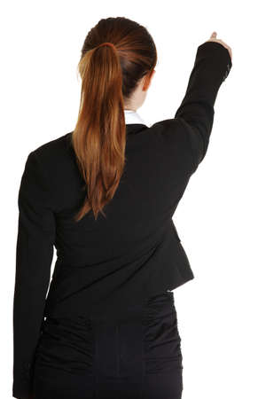Young business woman pointing at something in her back, isolated on white background  photo