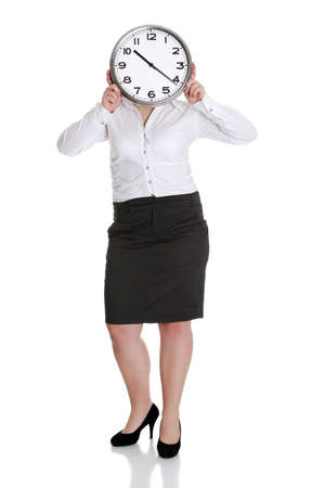 corporate waste: Businesswoman with clock, isolated on white - time concept
