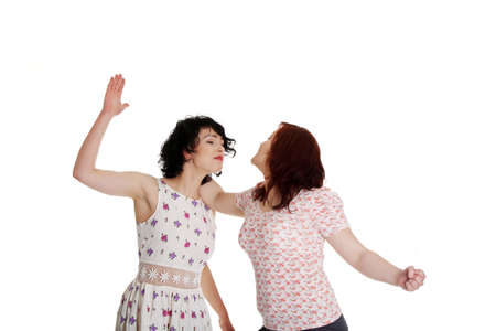 Two women fight, isolated on white background