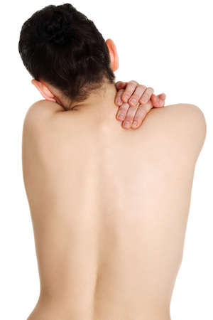 back light: Young woman with pain in her back. Isolated