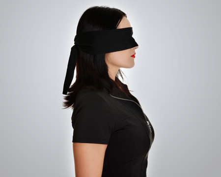 Blindfold business woman, over grey background photo