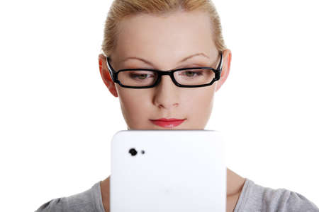 Beautiful happy young blond caucasian woman using tablet computer , isolated on white Stock Photo - 15009962