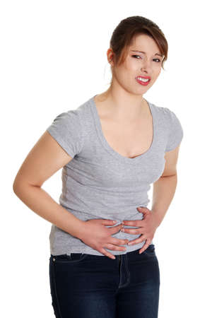 stomach pain: Woman with stomach issues , isolated on white Stock Photo