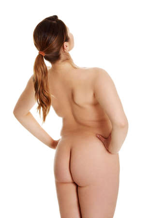 Rear view of nude young woman isolated on white background Stock Photo - 15003116