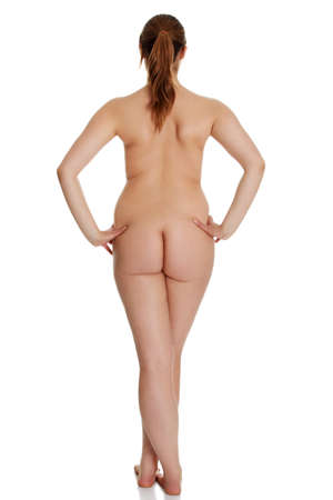 undressed: Rear view of nude young woman isolated on white background
