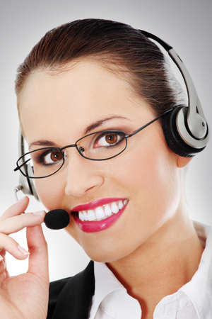 Portrait of a successful young female call centre employee wearing a headset photo