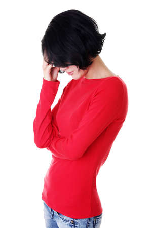 Young sad woman, have big problem or depression, over white background Stock Photo - 15010800