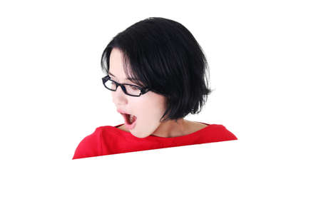 Shocked woman holding blank board, isolated on white Stock Photo - 15010783