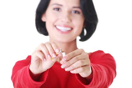 Young woman with broken cigarette. Stop smoking concept. 版權商用圖片