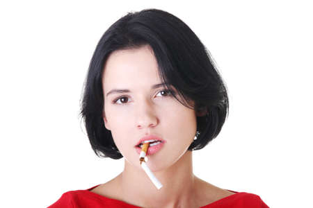 Young woman with broken cigarette. Stop smoking concept. photo