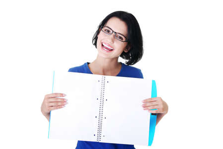 Studying happy young woman showing blank pages of her notebook for school. Stock Photo - 15010780