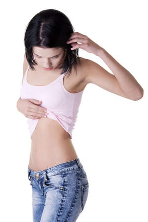 Young beautiful woman checking her belly Stock Photo - 15070239