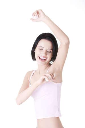 axilla: Beautiful young woman using antiperspirant Stock Photo