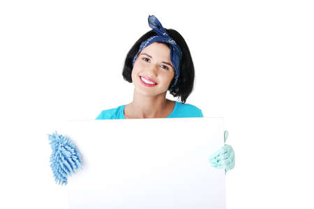 Smiling happy cleaning woman showing blank sign board. photo