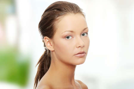 Young beautiful woman with fresh clean skin photo
