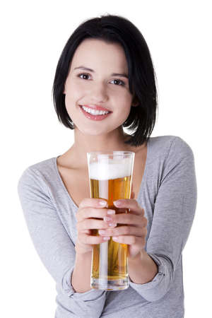 Beautiful and sexy young woman with beer, isolated on white  photo