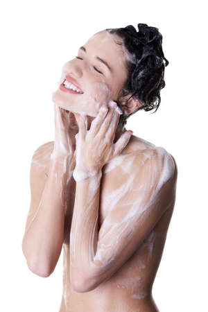 Young fit woman in shower washing her body Stock Photo - 15121399