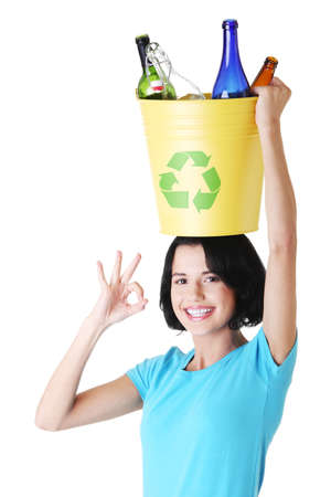 Beautiful young woman holding recycling basket isolated on white background.  photo