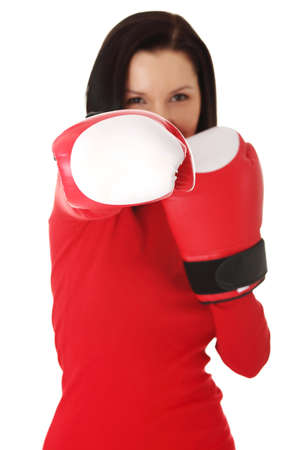 Young woman wearing a pair of boxing gloves. Student woman ready for exams photo