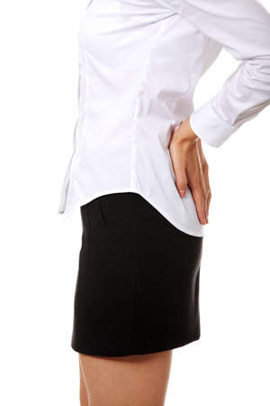 Business woman with back pain after long work.  Stock Photo - 15458915
