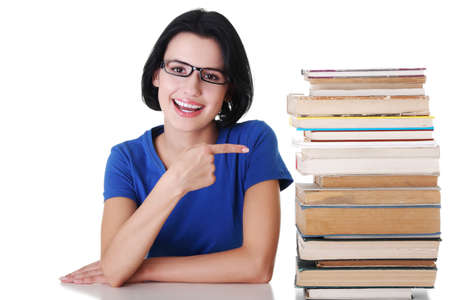 Happy smiling young student woman with books, isolated on white background photo