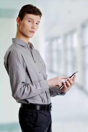 Young businessman using tablet computer  Stock Photo - 16676137