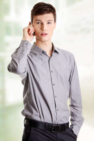 Young businessman calling by mobilephone. Stock Photo - 16676141